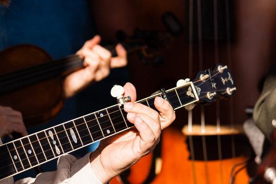 Banjo fret board being played