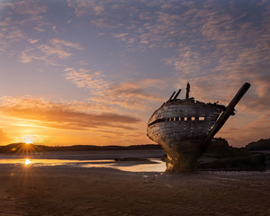 Irish ship wreck at sunset, the famous Bad Eddie located in Bunbeg.