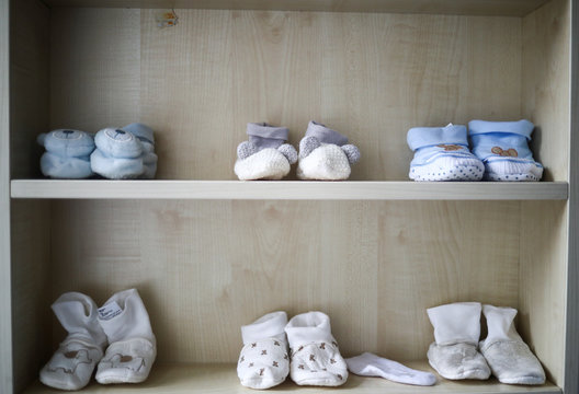 Pairs of baby shoes belonging to George Khnaisser, whose mother was in labour at the moment of the Beirut port blast, are seen on a shelf in the family home in Jal el-Dib