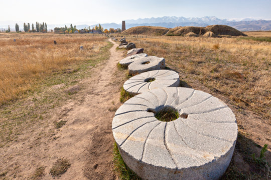 Grindstones in the ruins of the ancient site of Balasagun known also as Burana Tower, in Kyrgyzstan