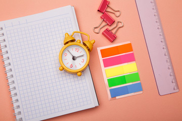 Colorful pink school background with school supplies. Back to school. Flat lay.
