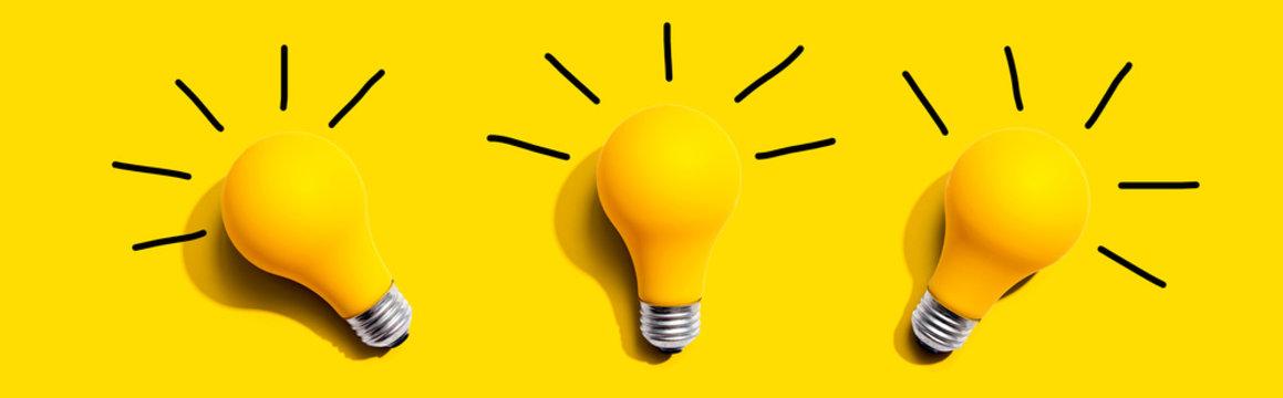 Three yellow light bulbs - flat lay from above