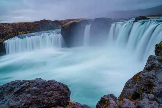 Long exposure shot of Goðafoss Waterfall on a gloomy autumn afternoon