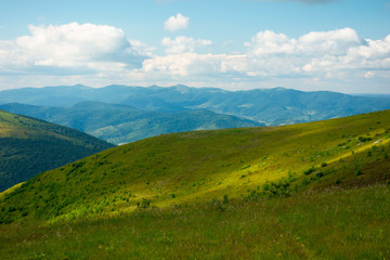 summer landscape of runa mountain. grassy hills of alpine meadow (polonyna). beautiful destination of ukrainian carpathians. clouds on the sky