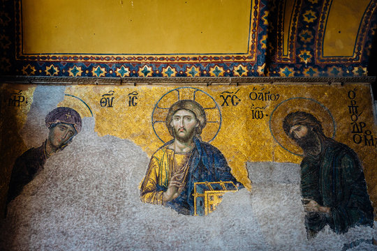 Istanbul, Turkey - August 14, 2018: An ancient Byzantine Christian mosaic on a wall of Hagia Sophia temple in Istanbul, Turkey.