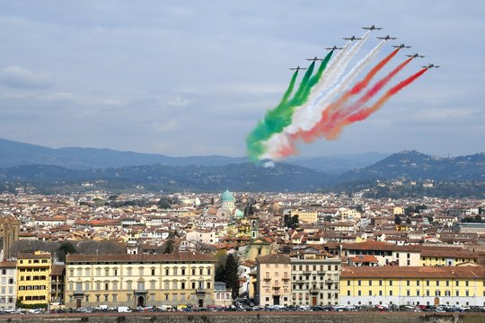 Airshow of PAN Frecce Tricolori. The Frecce Tricolori in the sky of Florence for 95th birthday of the Italian Air Force in Florence. The team flies the Aermacchi MB-339-A/PAN.