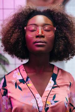 Night club neon light closeup portrait of young beautiful black african american woman