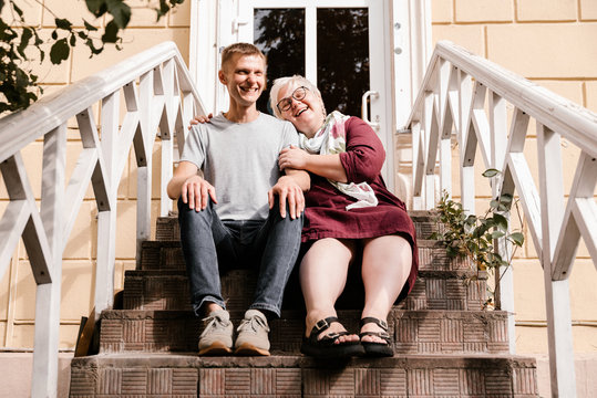Close up of Cheerful Couple Sitting on Staircase