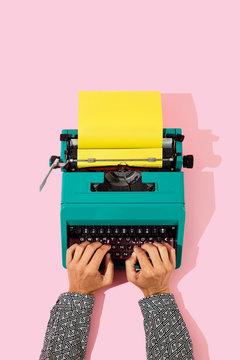 typing in a blue typewriter