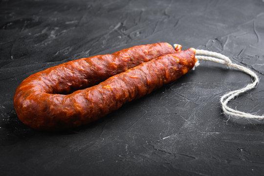 Traditional chorizo sausages  on black background