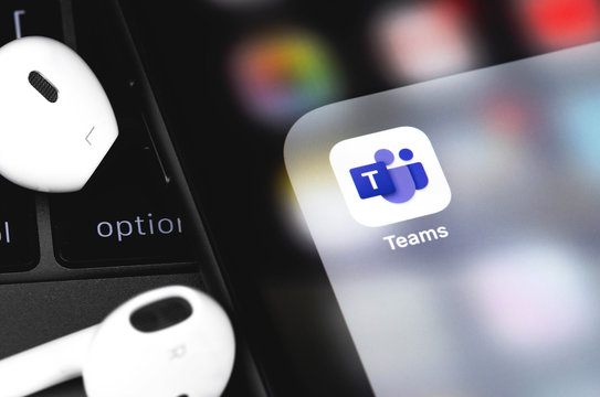 Microsoft Teams on the screen iPhone with Earpods. Microsoft Teams is an enterprise platform. Moscow, Russia - July 12, 2020