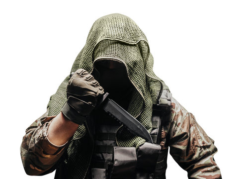 Fully equipped soldier in tactical net scarf, multi-camouflaged military shirt with knife, reverse grip.