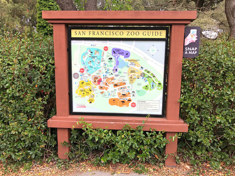 San Francisco, CA - Aug 10, 2020: Map along pathway at San Francisco Zoo with sign to snap a map. Contactless paperless maps now the norm as a result of the coronavirus pandemic.