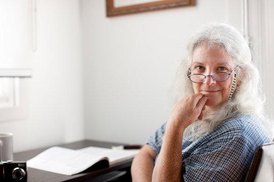 Caucasian woman sitting desk