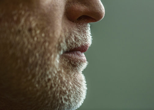Close up of chin and beard of Caucasian man