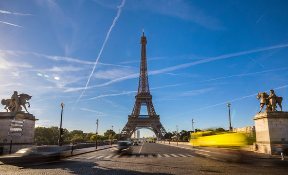 Road leading to Eiffel Tower against cloudy sky, Paris, France