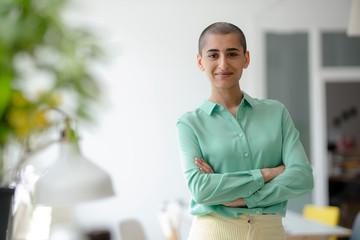 Portrait of a confident woman in a loft