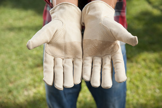 A man with clean gloves holds his hands out