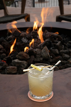 margarita by a fire pit