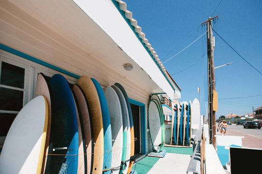 surfboard storage racks in surf shop outside