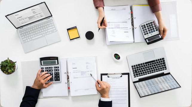Auditors Calculating Corporate Invoicing