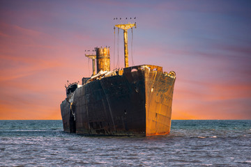 Acrylic Prints Shipwreck Shipwrecked. Old rusty wreck abandoned in the sea water.
