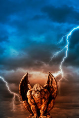 gargoyle statue over  stormy sky with lightings like fantasy, demon, mythic concept