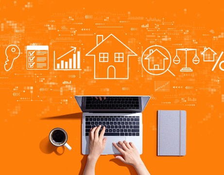 Real estate theme with person using a laptop computer