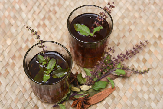 Indian Masala Chai black tea, traditional Tulsi herbal tea beverage with or without milk and spices Kerala India. Two cups organic ayurvedic  herbal drink India, good in winter for immunity boosting.