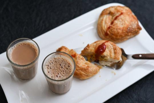 Indian milk tea, Chai and puffs, Kerala Snacks popular hot and spicy tea time food. Traditional food for Ramadan, Eid, Iftar pary, Onam, Vishu. Local street food of India.