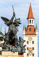 Fototapete - Marienplatz Square detail, Munich, Germany. Statue of angel closeup on background of Altes Rathaus or Old Town Hall
