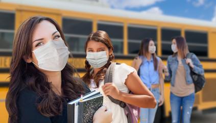 Students Near School Bus Wearing Medical Face Masks During Coronavirus Pandemic