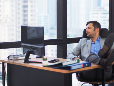 Professional Businessman resting or relaxing after break time in office, bore or unhappy action