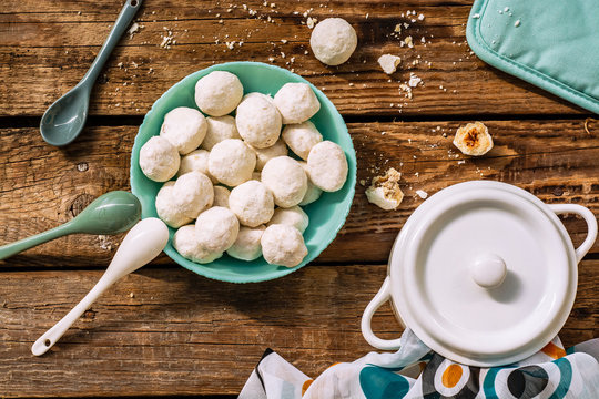 Traditional Christmas snowballs cookies, biscuits covered sugar powder . Top view
