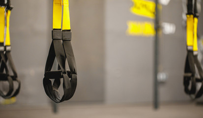 Trx straps in urban modern gym. A fitness equipment called trx that was prepared for playing at noon in a gym.