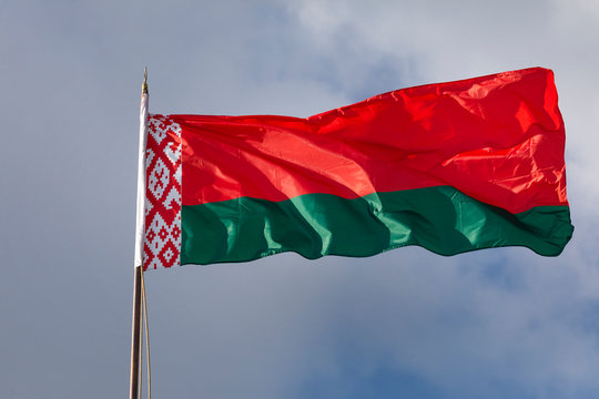 Close-up view of the national flag of the Republic of Belarus fluttering in the wind against the sky on a sunny day