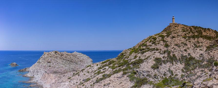 Panoramic view of Mediterranean Sea with lighthouse from Belvedere di Capo Sandalo, Carloforte, Sardinia, Italy