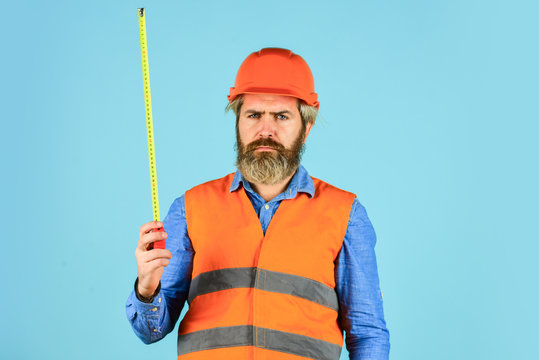 Make measurements apartment renovation. Safety Engineer Measure Acceptable Parameters. Builder with tape measure. Custom made furniture. Worker use tape measure. Size concept. Hipster in hard hat