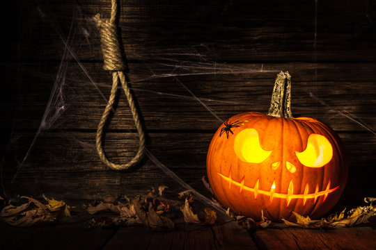 Halloween pumpkin head jack on wooden background