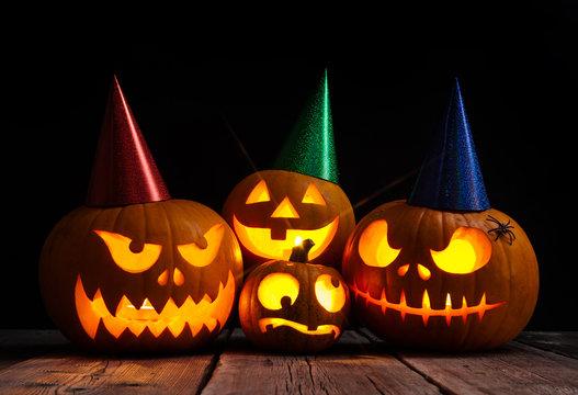 Halloween pumpkin head jack lantern on dark wooden background