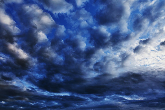 Beautiful summer blue sunset clouds. Background with a gray and blue sky for Photoshop.