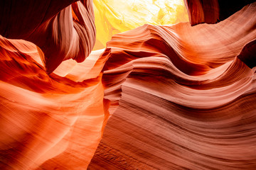 Mysterious Lower Antelope Canyon in Page Arizona with natural landscapes of bright sandstones stacked in flaky fire waves in a narrow sandy labyrinth