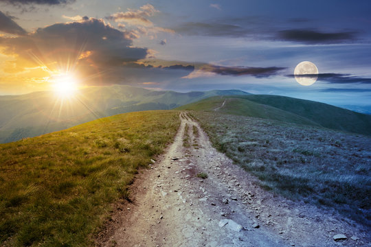day and night time change concept above the mountain road through grassy meadow. wonderful summer adventure in twilight beneath a sky with sun and moon.