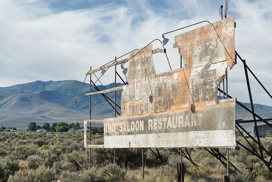 Old billboard of a long forgotten truck stop.