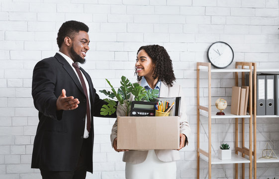 First day at office. African American businessman welcoming new female employee to his team at office