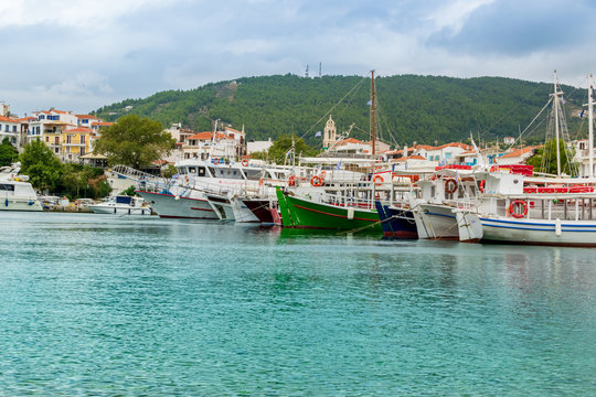 Skiathos, Greece - boats docked on the old port on a cloudy day
