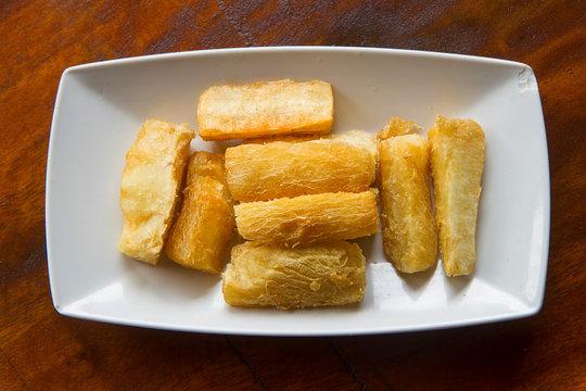 Deep fried cassava root . Brazilian Mandioca Frita (deep fried cassava/ manioc/yuca). Feijoada side dish