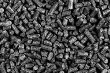 Photo sur Aluminium Texture de bois de chauffage White and black wood pellets texture background. natural pile of wood pellets. organic biofuels. Alternative biofuel from sawdust. pile of compressed wood pellets