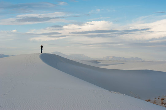Man who is walking at White Sands National park, NM