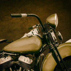 Sepia toned image of a fourties vintage motorcycle